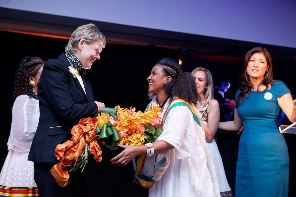 Gillian Slinger with flowers for Beriha Tsegay